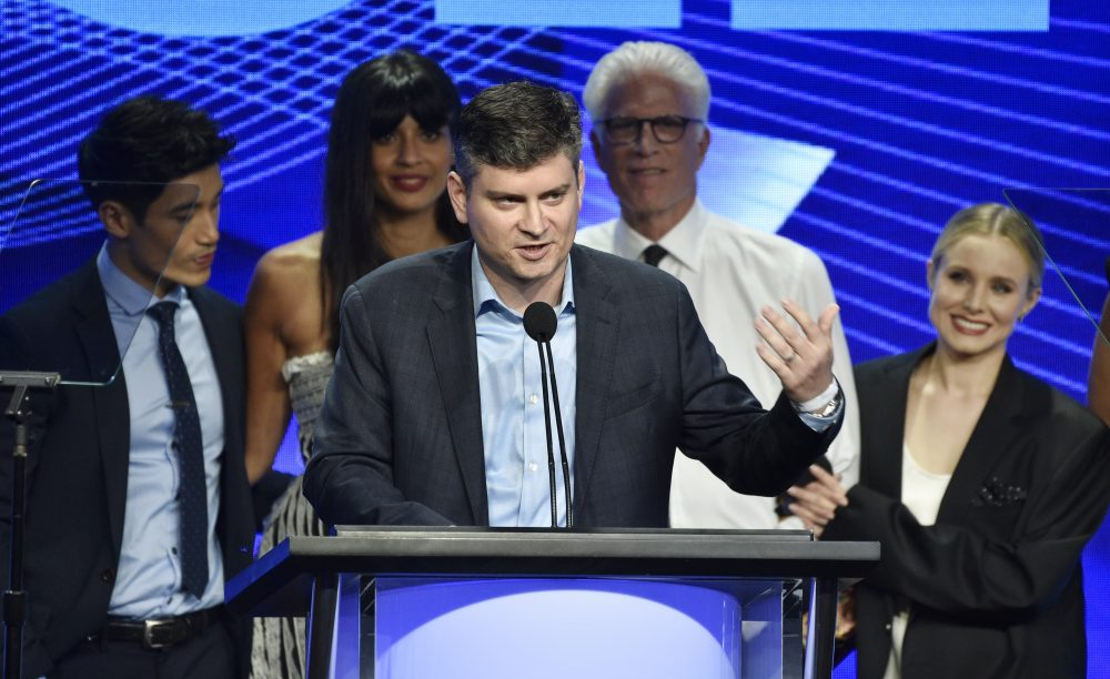 "In this Aug. 4, 2018 file photo, Michael Schur, center, creator and executive producer of the television series ""The Good Place,"" accepts the Outstanding Achievement in Comedy Award as cast members, from left, Manny Jacinto, Jameela Jamil, Ted Danson and Kristen Bell look on at the 34th annual TCA Awards during the 2018 Television Critics Association Summer Press Tour, in Beverly Hills."