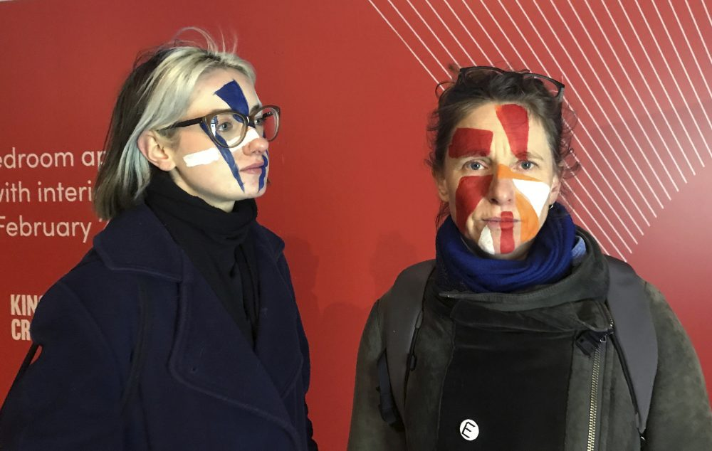 Artists Georgina Rowlands, left, and Anna Hart stand for a photo with their faces painted Feb. 17. They're two of the four founders of the Dazzle Club, started last year to provoke discussion about the growing using of facial recognition technology.