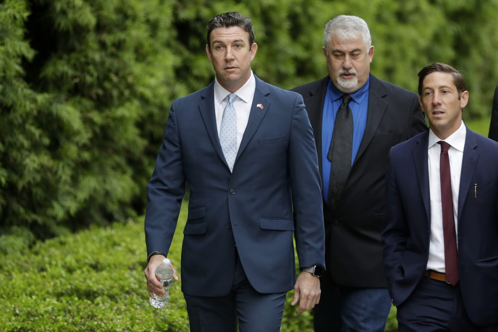 Convicted ex-Rep. Duncan Hunter, left, served six terms representing one of Southern California's last solidly Republican districts before he resigned. The former congressman will serve almost a year in prison.