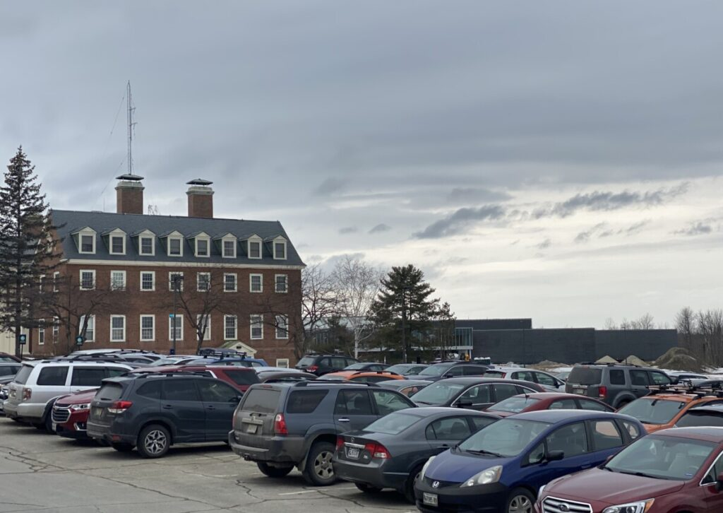 Cars are parked in a lot at Colby College in Waterville, where some students are criticizing towing practices by campus security.