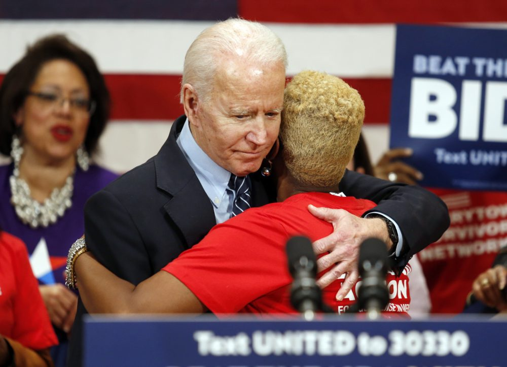 Democratic presidential candidate former Vice President Joe Biden hugs Crystal Turner of Columbus, Ohio, with Moms Demand Action during a campaign rally in Columbus, Ohio, on Tuesday. Both Biden and fellow Democratic presidential candidate Sen. Bernie Sanders abruptly canceled election-night rallies Tuesday night in Cleveland amid concerns over the spread of the new coronavirus – as public health fears began transforming the 2020 race.