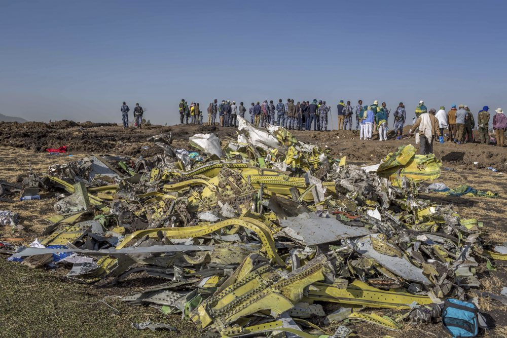 Wreckage is piled at the crash scene of Ethiopian Airlines flight 302 near Bishoftu, Ethiopia, on March 11, 2019. The year since the crash of an Ethiopian Airlines Boeing 737 Max has been a journey through grief, anger and determination for the families of those who died, as well as having far-reaching consequences for the aeronautics industry as it brought about the grounding of all Boeing 737 Max 8 and 9 jets, which remain out of service.