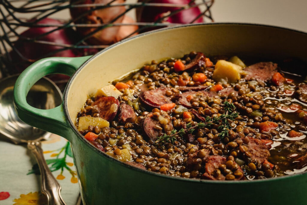 The lentil stew is studded with carrots, potatoes and smoked sausage.