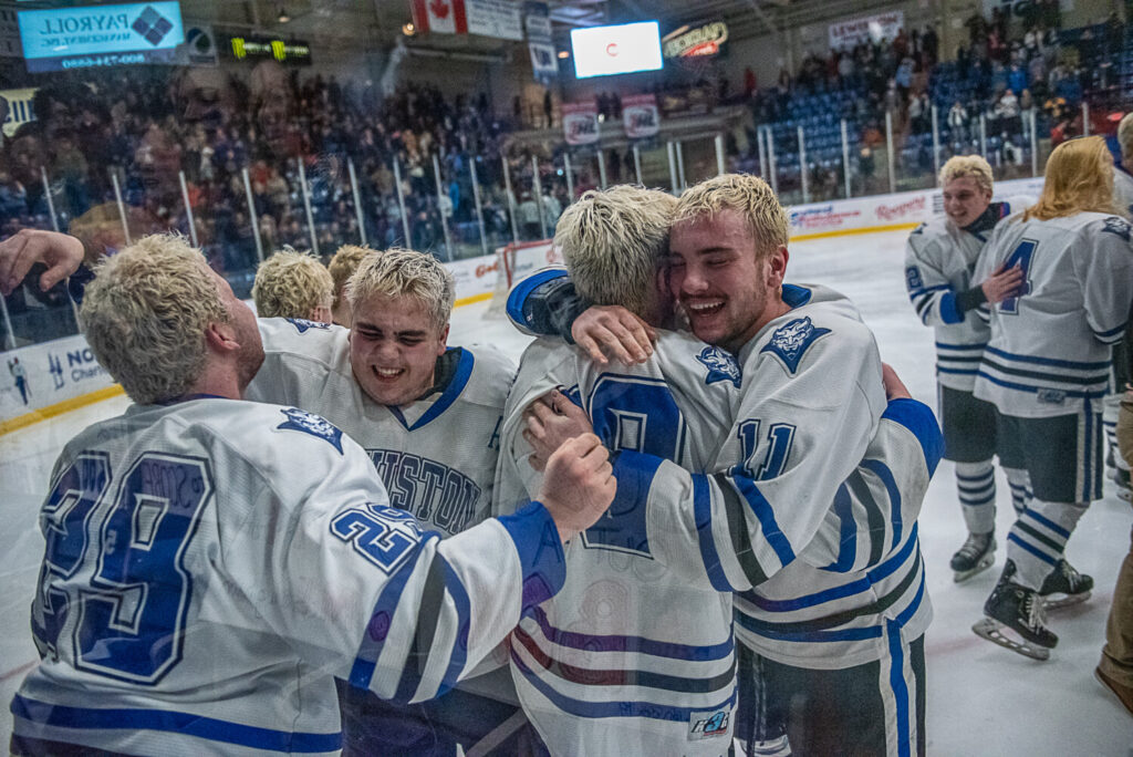 Lewiston players celebrate Saturday night after they capped a 21-0 season with a 2-1 double-overtime victory over Scarborough.