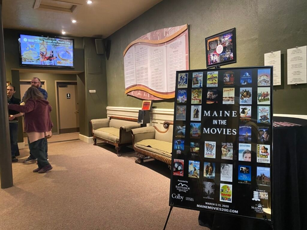 A Maine in the Movies promotional poster is displayed Thursday outside the theater at the Waterville Opera House.