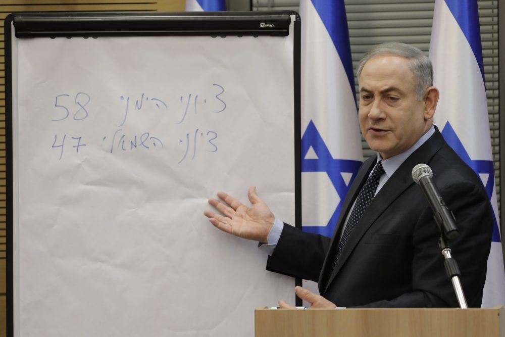 Israeli Prime Minister Benjamin Netanyahu explains some elections results Wednesday during a meeting with his nationalist allies and his Likud party members at the Knesset, Israeli Parliament, in Jerusalem.