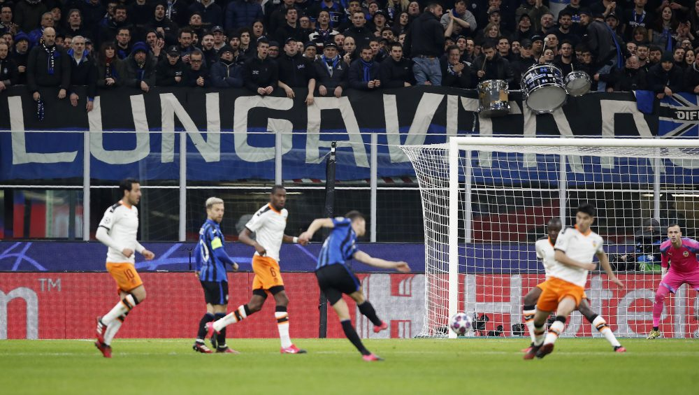 "In this Feb. 19 file photo, spectators sit in the stands during the Champions League round of 16, first leg, soccer match between Atalanta and Valencia at the San Siro stadium in Milan, Italy. It was the biggest soccer game in Atalanta's history and a third of Bergamo's population made the short trip to Milan's famed San Siro Stadium to witness it. Nearly 2,500 fans of visiting Spanish club Valencia also traveled to the Champions League match. More than a month later, experts are pointing to the Feb. 19 game as one of the biggest reasons why Bergamo has become one of the epicenters of the coronavirus pandemic — a ""biological bomb"" was the way one respiratory specialist put it — and why 35% of Valencia's team became infected. The new coronavirus causes mild or moderate symptoms for most people, but for some, especially older adults and people with existing health problems, it can cause more severe illness or death."