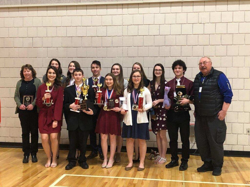 Monmouth Academy Academic Decathlon team front from left are  Amber Currie, Ostin Hasenfus-Smith, Rhayna Poulin and Olivia Degen.  Back from left are Coach Cathy Foyt, Kaitlin Hunt, Natalie Grandahl, Ed Zuis, Delaney Houston, Holly Hunt Cammie Houston, Joe Crocker and Coach Scott Foyt