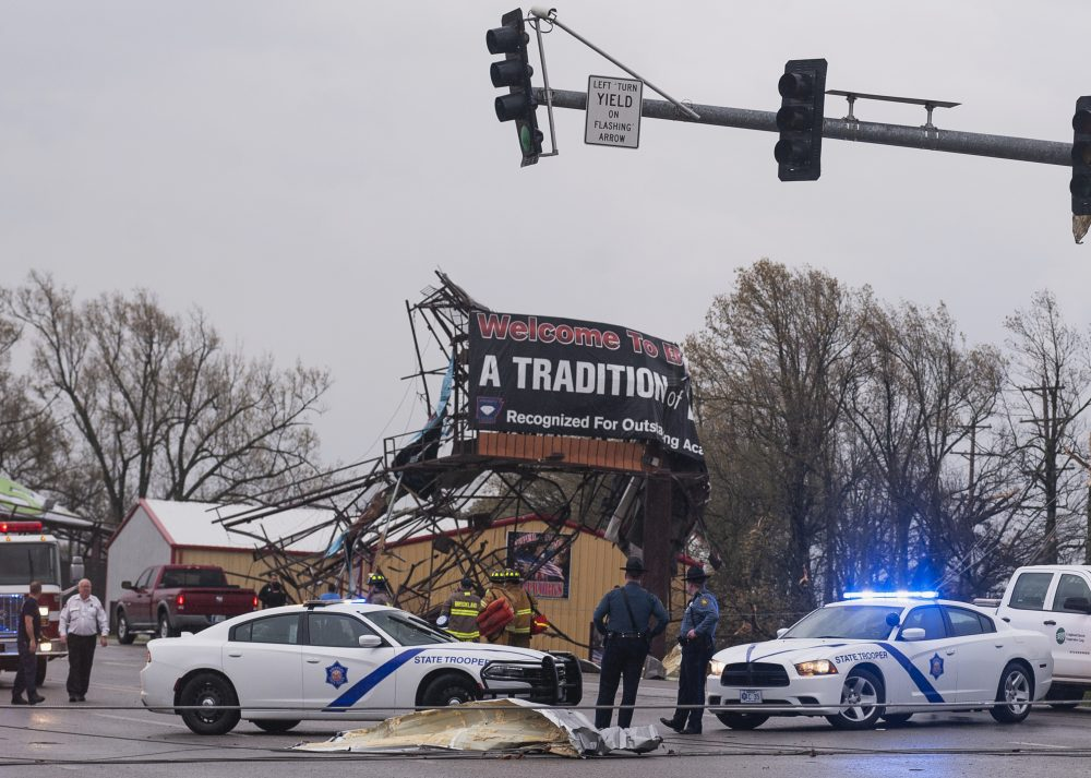 Arkansas State Police and other first responders survey the damage in Jonesboro,  on Saturday after a tornado touched down in the area.
