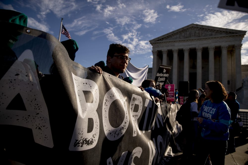 Anti-abortion rights demonstrators rally outside the Supreme Court in Washington on Wednesday as the court takes up the first major abortion case of the Trump era, an election-year look at a Louisiana dispute that could reveal how willing the more conservative court is to roll back abortion rights.