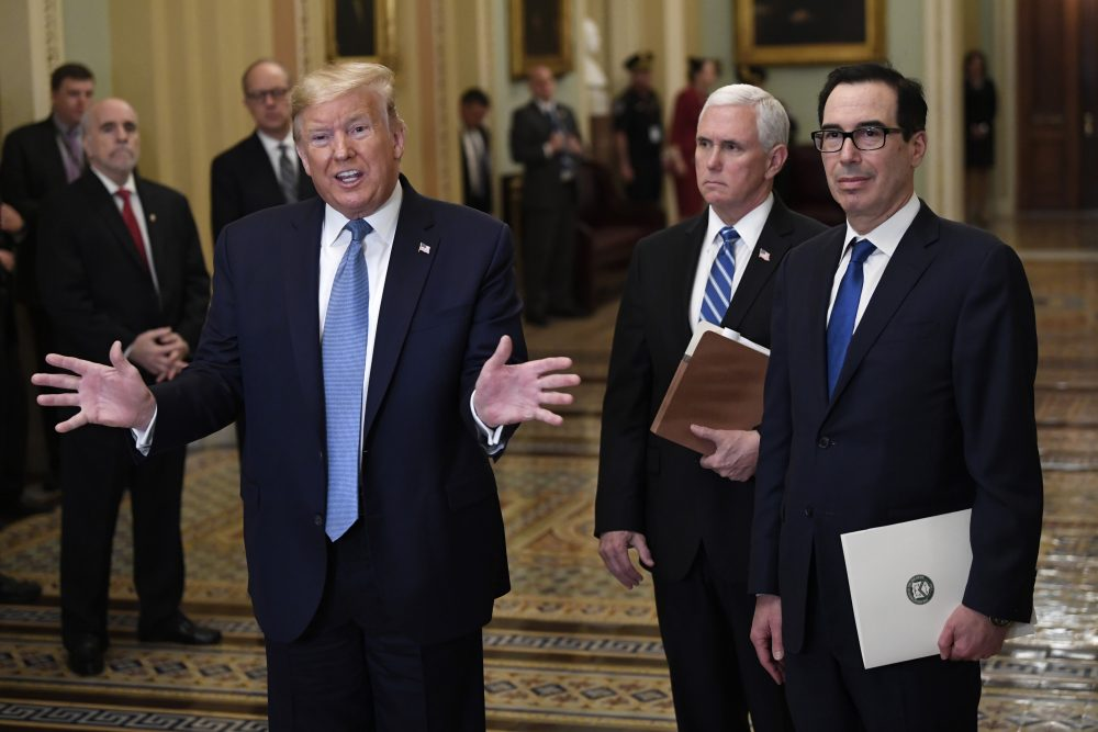 President Trump, along with standing with Vice President Mike Pence and Treasury Secretary Steven Mnuchin, right, talks to reporters about the coronavirus outbreak on Tuesday on Capitol Hill in Washington.