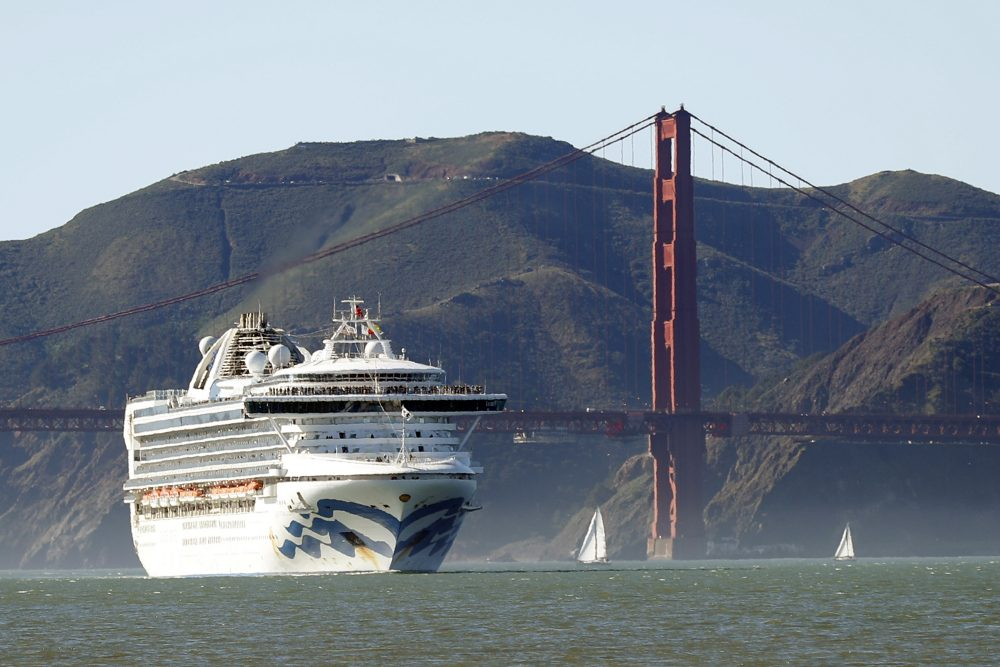 The Grand Princess cruise ship passes the Golden Gate Bridge Feb. 11 as it arrives from Hawaii in San Francisco. Scrambling to keep the coronavirus at bay, officials ordered the cruise ship to hold off the California coast Thursday to await testing of those aboard, after a passenger on an earlier voyage died and at least four others became infected.
