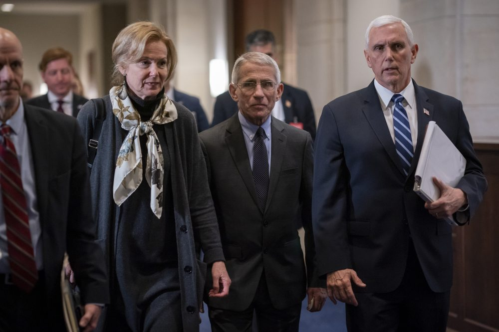 Dr. Deborah Birx, left, the coronavirus response coordinator, and Dr. Anthony Fauci, center, director of the National Institute of Allergy and Infectious Diseases, walk with Vice President Mike Pence, right, on Capitol Hill in Washington on Wednesday. Congress on Thursday sent to President Trump an $8.3 billion bill to fund the government's response to the public health emergency.