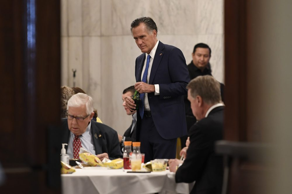Sen. Mitt Romney, R-Utah, attends a Republican policy lunch Friday on Capitol Hill in Washington to work on sweeping economic rescue plan amid the pandemic crisis and nationwide shutdown that's hurtling the country toward a likely recession.
