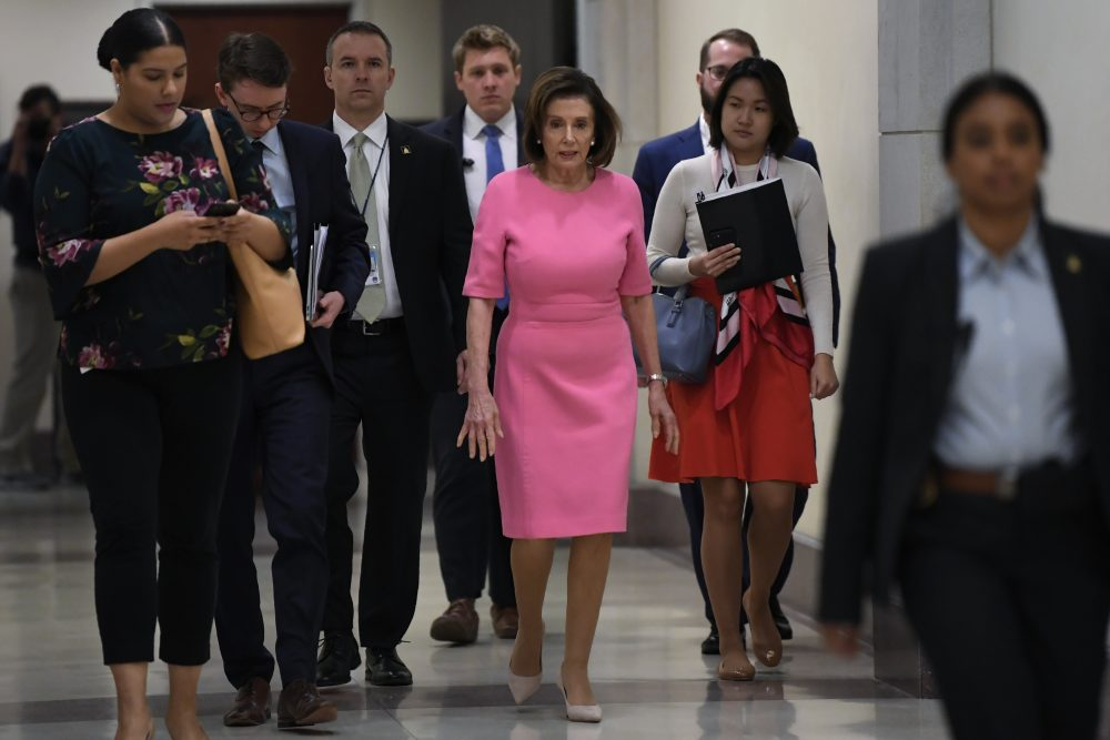 House Speaker Nancy Pelosi of Calif., heads to a news conference on Capitol Hill in Washington on Thursday. Pelosi said the House is expected to pass the massive coronavirus aid package with bipartisan support on Friday.