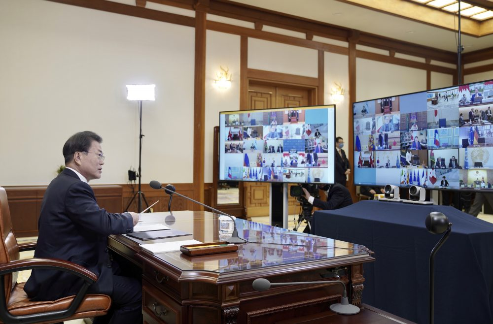 South Korean President Moon Jae-in attends an emergency G-20 virtual summit Thursday to discuss the coronavirus outbreak at the presidential Blue House in Seoul, South Korea.
