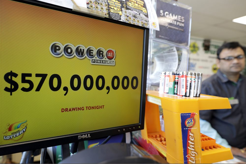 A Powerball lottery sign displays the lottery prizes at a convenience store in Chicago in January 2018. Lottery jackpots are going to shrink as the coronavirus pandemic tamps down lottery sales.