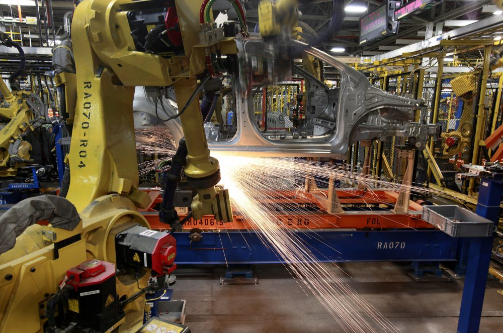 Robots weld a Chevrolet Sonic at the General Motors Orion Assembly plant May 19, 2011, in Orion Township, Mich. General Motors, Ford, jet engine maker Rolls-Royce and other companies are talking to their governments about repurposing idled factories to produce vital goods to fight the coronavirus such as ventilators and surgical masks.
