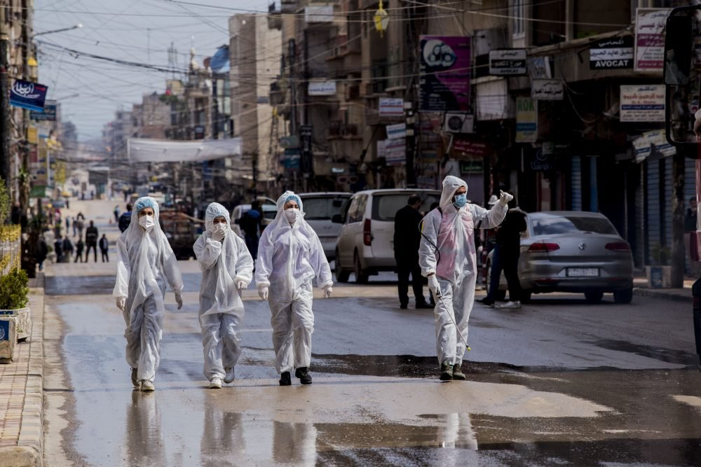 Medical workers oversee the disinfection of the streets to prevent the spread of coronavirus in Qamishli, Syria, Tuesday, March 24.