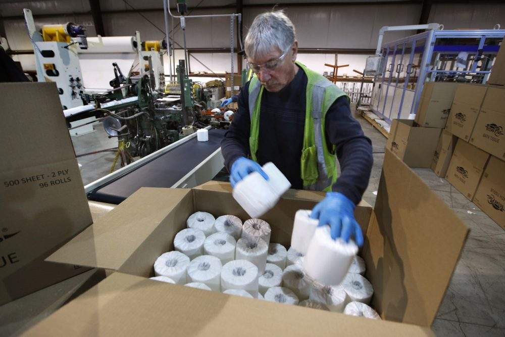 Scott Mitchell fills a box with toilet paper at the Tissue Plus factory, Wednesday, March 18, in Bangor.