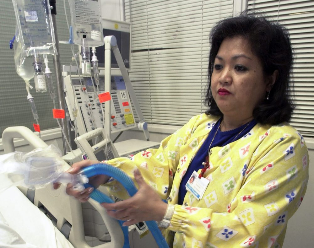 Lovely R. Suanino, a respiratory therapist at Newark Beth Israel Medical Center in Newark, N.J., demonstrates setting up a ventilator in the intensive care unit of the hospital in 2005. U.S. hospitals bracing for a possible onslaught of coronavirus patients with pneumonia and other breathing difficulties could face a critical shortage of ventilators.