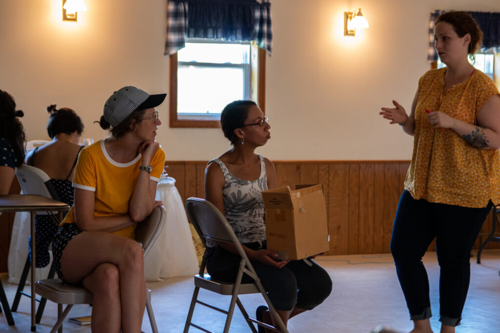 "Writer Christina Richardson, middle, listens to company members Kerry Anderson, left, and Tarra Bouchard during a workshop last summer for the play ""[Storage]."""