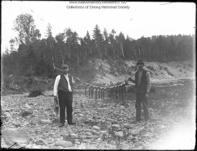 "Affectionately called ""squaretail,"" brook trout have long been a favorite among Maine fishermen. Here, fishermen in 1905 at Valley Brook near Farmington display their catch."