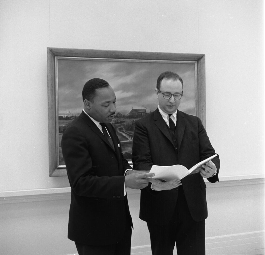 """The Rev. Martin Luther King Jr., left, and curator Marvin Sadik, director of the Bowdoin Art Museum museum, as King toured the exhibition """"The Portrayal of the Negro in American Painting"""" in May 1964."""