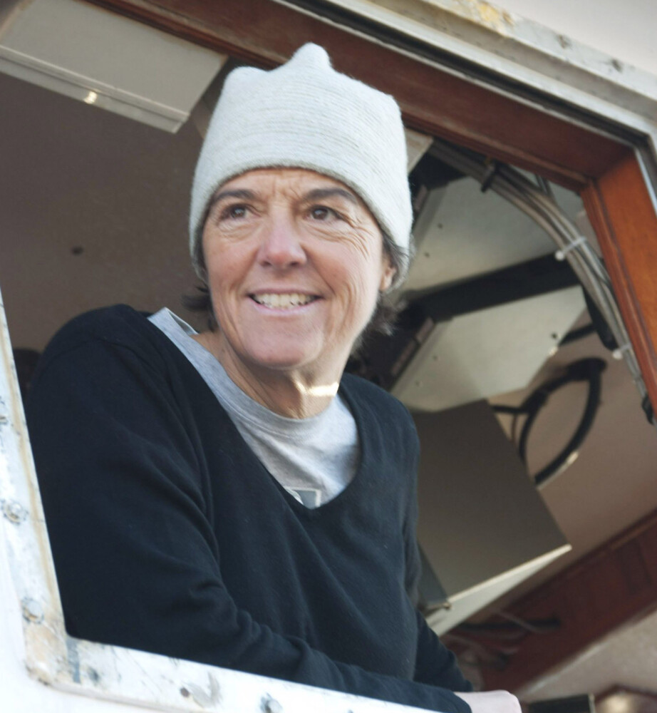 Capt. Linda Greenlaw, of the f/v Hannah Boden, looks out from the vessel window at the Portland Fish Exchange in November 2010.