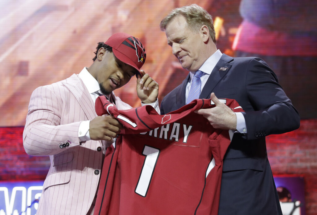 Kyler Murray, the No. 1 pick in the 2019 NFL draft, is handed a jersey by NFL Commissioner Roger Goodell. The No. 1 pick in the 2020 draft will not get a moment with the commissioner because the draft will be completely virtual due to the coronavirus pandemic.