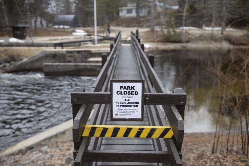 A sign tells visitors that Songo Lock in Casco is closed to visitors Wednesday because of coronavirus. Wednesday marked the traditional opening day of Maine's fishing season.
