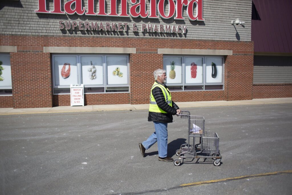 Bill Dunn, a volunteer with The Yarmouth Community Coronavirus Task Force, shops on March 31 for a Yarmouth resident who wasn't able to go to the store.