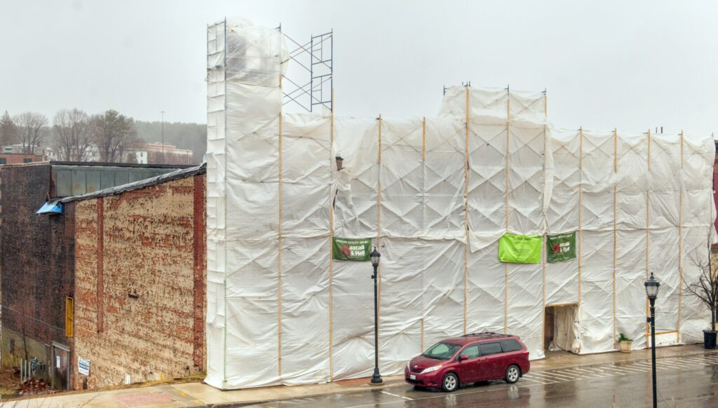 The facade of the Colonial Theater shrouded in plastic covered scaffolding, seen Friday in downtown Augusta.