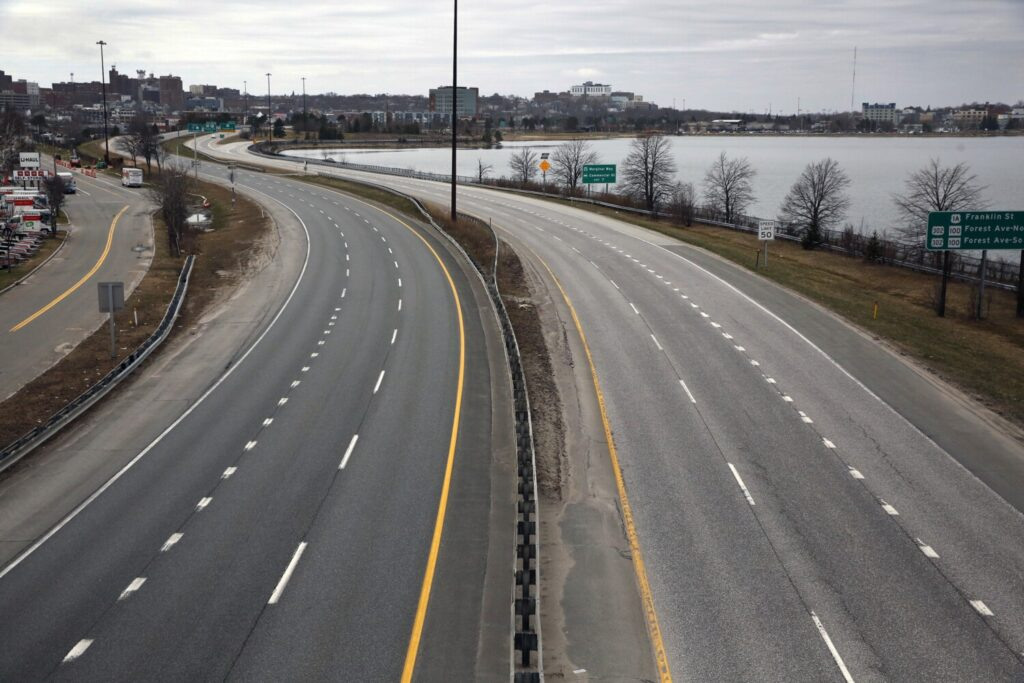 Interstate 295 in Portland is eerily empty at 10 a.m. Sunday, as viewed from the Washington Avenue overpass. Movement in densely populated urban areas of southern Maine has plummeted, while declines in some rural areas have been less pronounced.