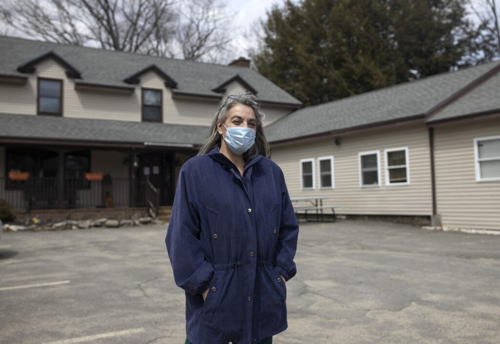 """Priscilla Heald, a personal support specialist for Assistance Plus, a home health care service, has been working in home healthcare for over 20 years. She said she now goes out only for what she needs, to protect herself and in turn the clients whose homes she must visit. """"People need us,"""" Heald said."""