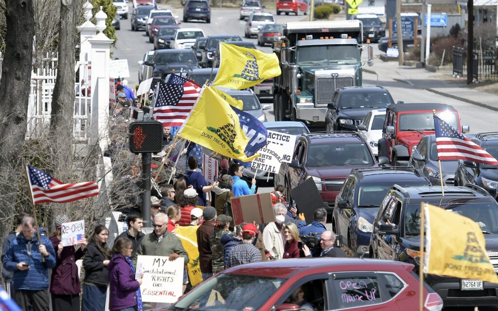 Protesters assemble Monday outside the Blaine House in Augusta. An estimated 300 people or so gathered  outside the Blaine House, which is the governor's mansion, and outside the State House across the street, to call for coronavirus restrictions to be lifted.