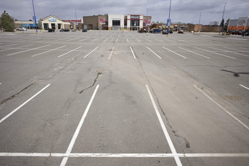 The parking lot of The Maine Mall in South Portland was nearly empty on April 22. Some analysts say the prolonged shutdown of stores may mean that some retailers won't survive.