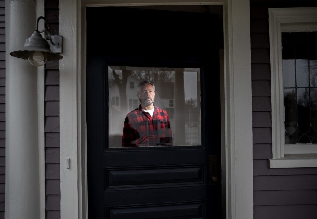 James Salomon, an architectural photographer seen at his home in Portland, lost most of his work shortly after the coronavirus pandemic hit. He's angry about the delayed rollout of benefits for self-employed workers.