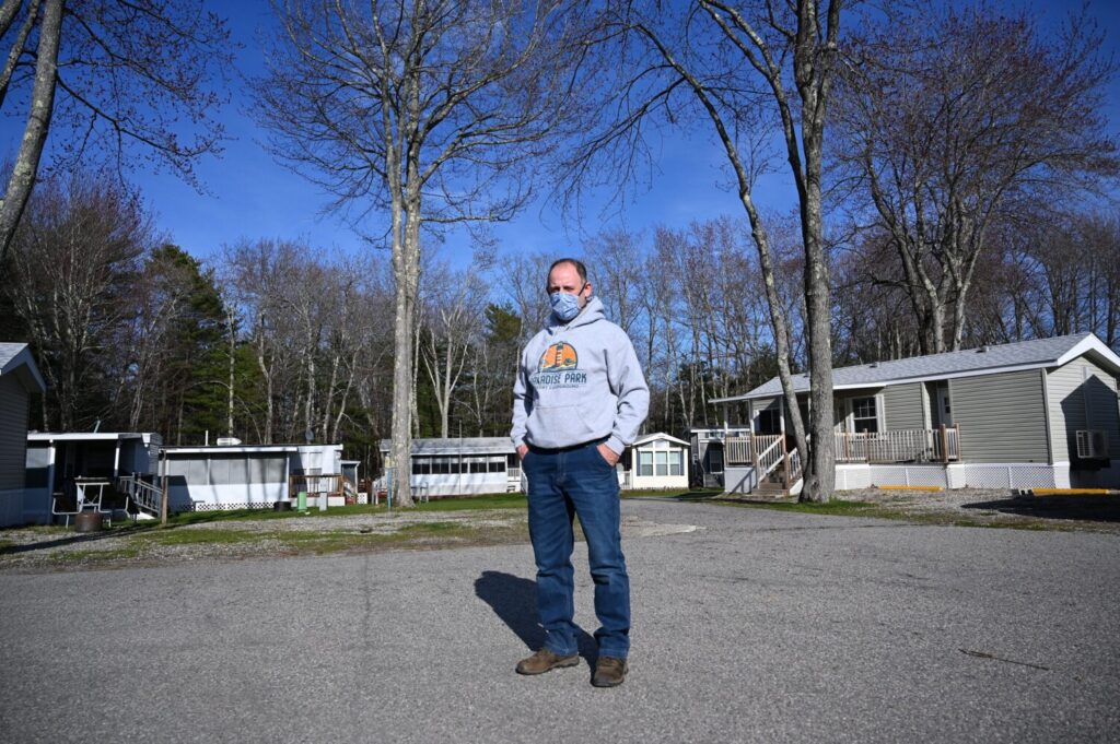 Mike Halle, owner of Paradise Park Resort Campground in Old Orchard Beach, stands in front of the property on Wednesday. Halle said the governor's reopening plan would cost him about 90 percent of his reservations for the summer because guests could not meet a requirement to self-quarantine for 14 days upon arrival.
