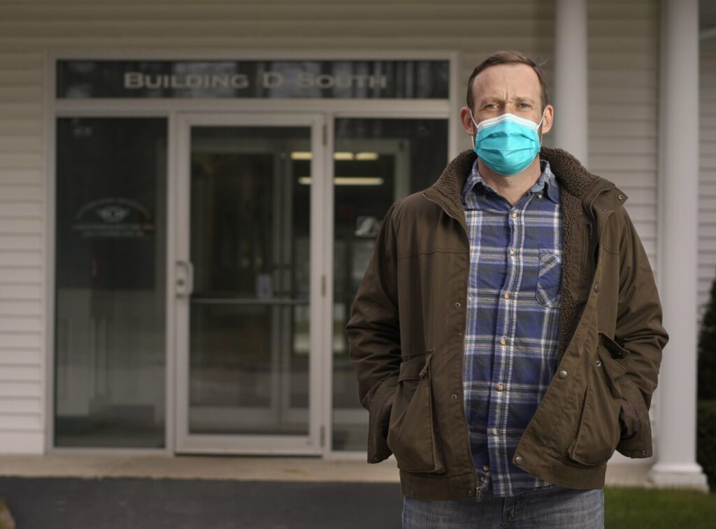 Orthodontist Chris Murphy stands outside his office in Scarborough on Thursday. Orthodontists and dentists were planning to reopen their practices Friday but have put those plans on hold because of a lack of guidance from the Mills administration.