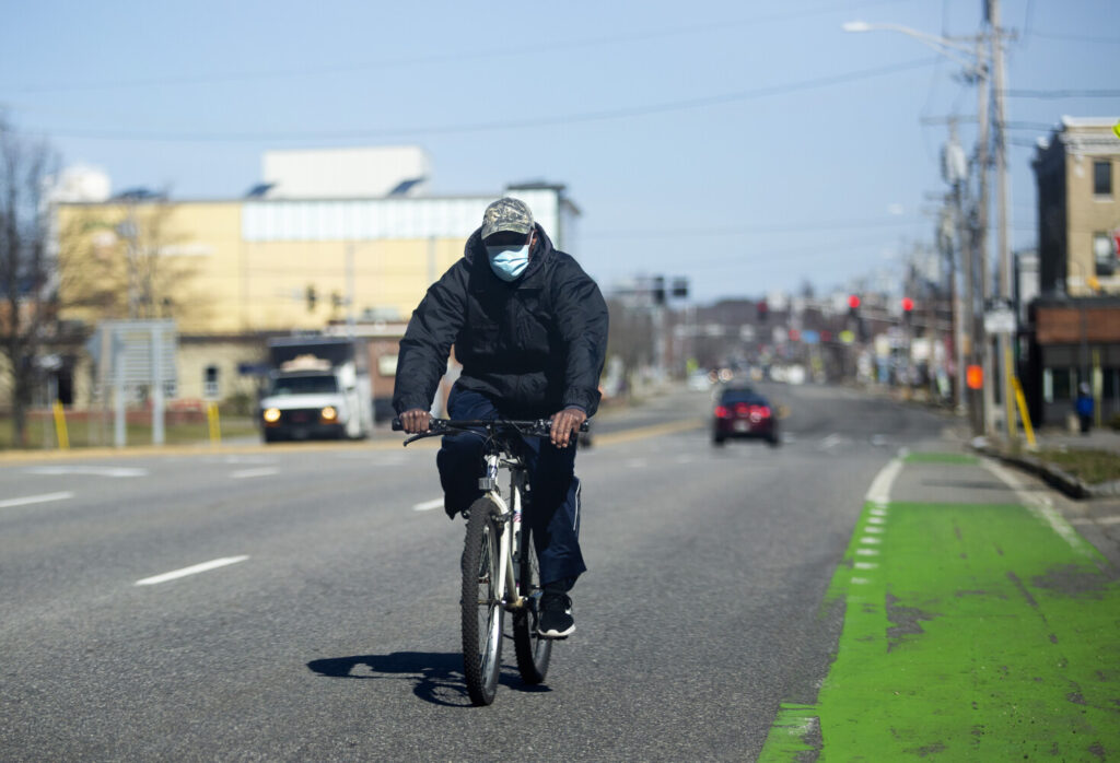 A man rides a bicycle on Forest Avenue in Portland on Wednesday, April 29.