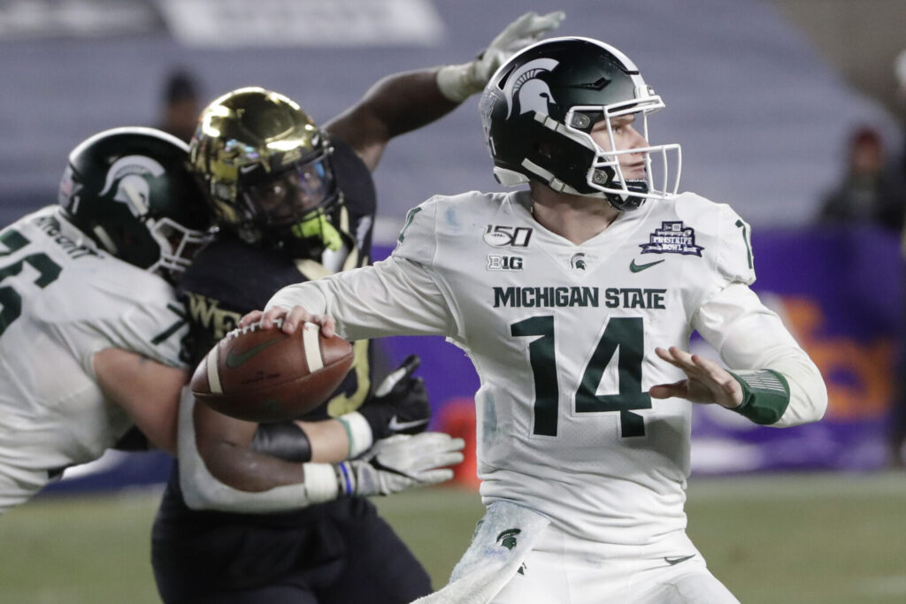 Michigan State quarterback Brian Lewerke signed as an undrafted free agent with the New England Patriots, according to his agent.