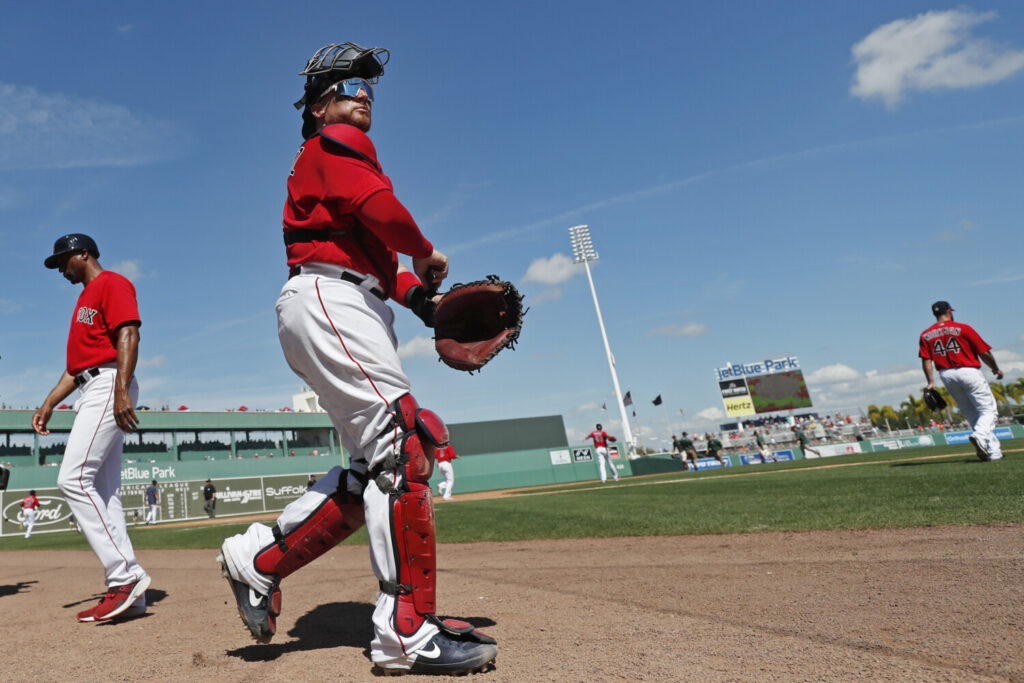 Boston Red Sox catcher Christian Vazquez takes the field on March 5 in Fort Myers, Florida. A reported proposal by Major League Baseball would make Fort Myers the Red Sox home this season if games are able to be played during the coronavirus pandemic.