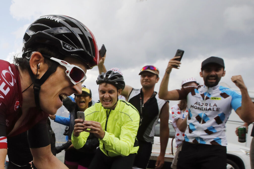 Spectators cheer Britain's Geraint Thomas during the 2019 Tour de France. The event was postponed on Tuesday, with hopes that it can still be held this year.