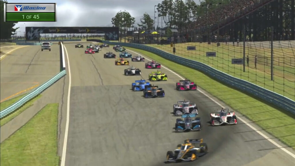 In this image taken from video provided by iRacing IndyCar, IndyCar Pato O'Ward, foreground, heads into a turn during opening lap of the American Red Cross Grand Prix virtual IndyCar race Saturday at Watkins Glen International.