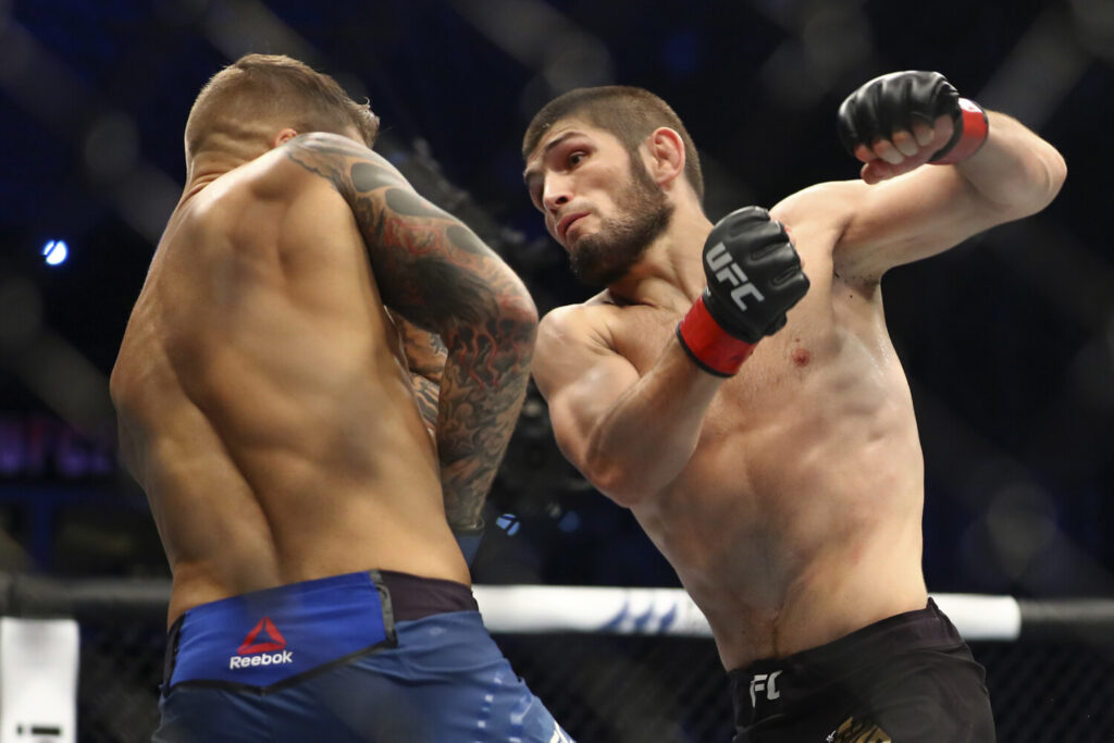 "FILE - In this Sept. 7 2019, file photo, Russian UFC fighter Khabib Nurmagomedov, right, fights with UFC fighter Dustin Poirier, of Lafayette, La., during lightweight title mixed martial arts bout at UFC 242 in Yas Mall in Abu Dhabi, United Arab Emirates. Nurmagomedov says he won't leave quarantine in Russia to fight, dealing another blow to UFC President Dana White's determination to hold UFC 249 in two weeks amid the coronavirus pandemic. Nurmagomedov made his announcement Wednesday, April 1, 2020, on Instagram, telling the mixed martial arts world to ""take care of yourself and put yourself in my shoes."" (AP Photo/Mahmoud Khaled, File)"