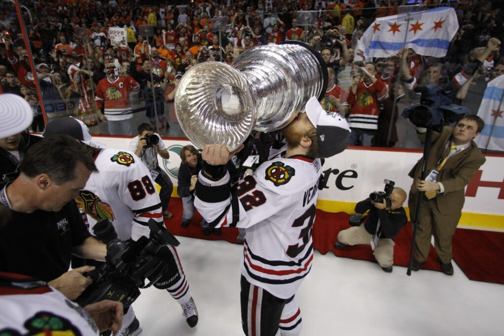 Chicago Blackhawks' Kris Versteeg celebrates with the Stanley Cup in 2010.  Versteeg announced his retirement on Tuesday.