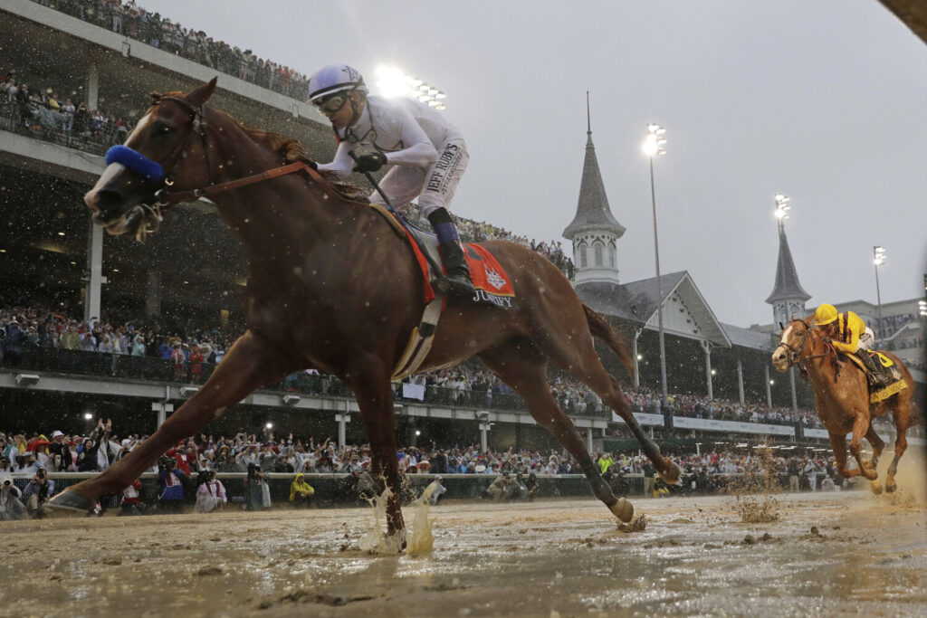 Mike Smith rides Justify to victory during the 144th running of the Kentucky Derby inon May 5, 2018 at Churchill Downs in Louisville, Ky. The move of the Triple Crown's first leg to Labor Day weekend due to the coronavirus pandemic will mark the first time the Derby won't run on the first Saturday in May since 1945.