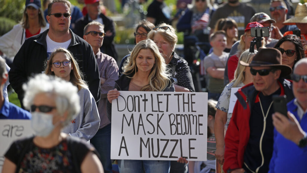 People gather during the Utah Business Revival rally, which wants Utah's economy to be re-opened, Saturday, April 18, 2020, in Salt Lake City. Utah will aim to reopen restaurants and gyms and resume elective surgeries in early May under a plan unveiled Friday, April 17, 2020,, by Gov. Gary Herbert to gradually reopen the economy that has been decimated by the coronavirus pandemic. (AP Photo/Rick Bowmer)