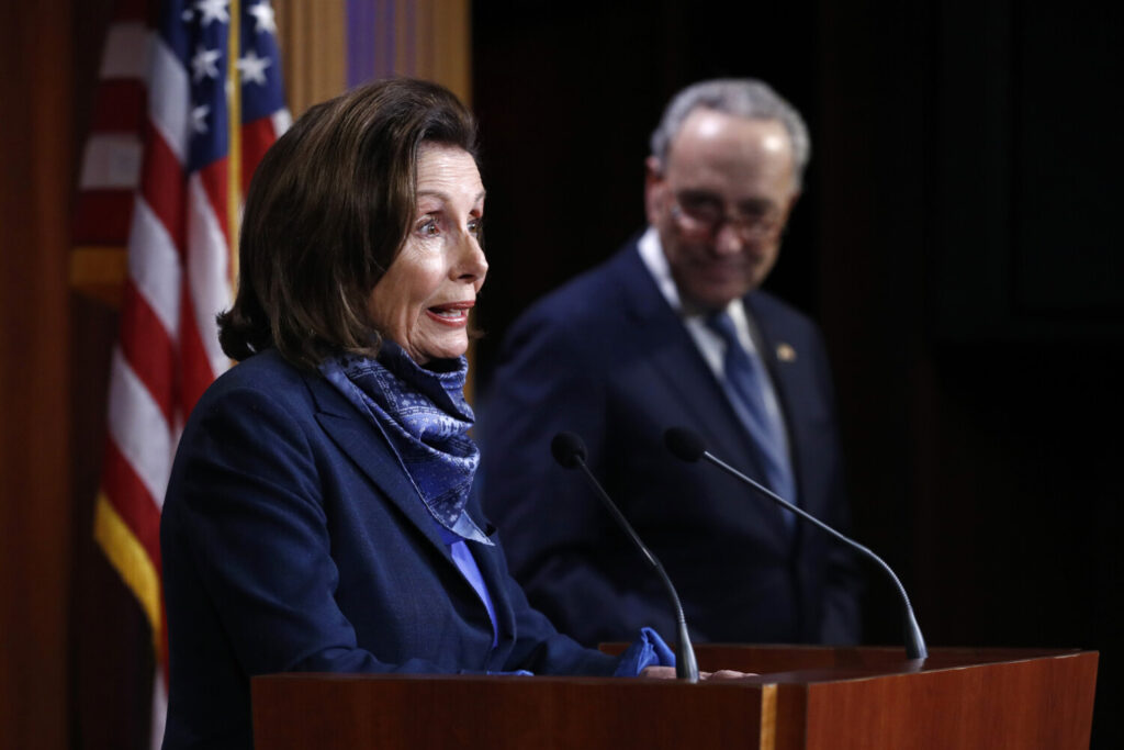 House Speaker Nancy Pelosi of California speaks with reporters alongside Senate Minority Leader Sen. Chuck Schumer of New York after the Senate approved a nearly $500 billion coronavirus aid bill on Tuesday on Capitol Hill in Washington.